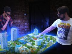 two-men-pointing-at-cityscape-on-holographic-table.tmb-large